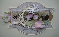 Handmade card by DT member Boukje with Craftables Basic Shapes - Label (CR1352), Square - for the flowers (CR1203), Punch Die - Sea Shells (CR1363), Creatables Flower Doily (LR0388), Tiny's Butteflies 2 (LR0357), Build-a-Rose (LR0398) and Design Folder Extra - Tire Track (DF3407) from Marianne Design