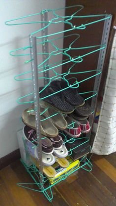 Shoes rack - made with clothes hangers and aluminum bar