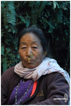 """when you travel on a bicycle you take the road less travelled and hear of stories of people and places. She is of the Bhutia clan of Sikkim, she is wearing a nose ring called """"Bullaki"""" which is adorned by married women of the region. More of this story on www.unventured.com"""