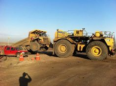 The trucks are big....but the tow trucks are much bigger!The wrecker is a 2160hp Caterpillar 793C
