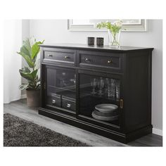 MALSJÖ Sideboard basic unit IKEA With a glass-door cabinet you can show off as well as protect your glassware or your favourite collection. Ikea Design, Black Sideboard, Sideboard Buffet, Rustic Sideboard, Side Board, Buffet Table Ikea, Black Buffet Table, Plastic Foil, Ikea Family