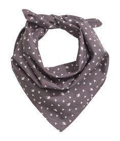 BABY EXCLUSIVE. Een sjaal van een dubbele laag geweven katoen met een geprint dessin. Afmetingen 40x40 cm.