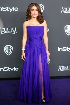 Salma Hayek In Gucci Salma went from wearing white Alexander McQueen on the carpet to this vibrant, purple Gucci number once the hour got late. Pop-of-color perfection!