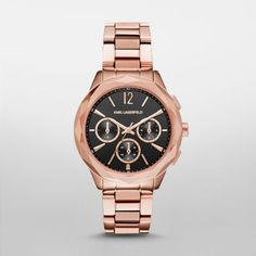 Optik Rose Gold-Tone Chronograph Watch Karl's signature faceted case adds an edgy, feminine feel to the rose gold-tone Optik watch. The black sunray chronograph dial is accented with rose gold-tone distorted stud indexes.