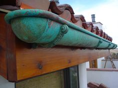 Half round gutter with patina