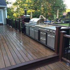This backyard project includes a multilevel Trex Deck with cooking area leading down to a Cambridge stone patio