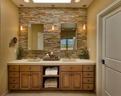 Master bath cabinets, counter, mirrors, wall color and brick accent wall.