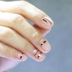gold stip tape minimalist nail design
