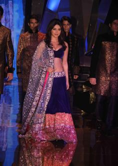 Manish Malhotra. Blue velvet lehnga with pink and coral border
