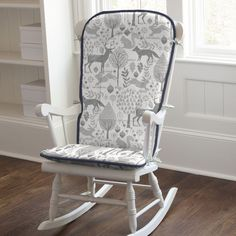 """Rocking Chair Cushion in Navy and Gray Woodland by Carousel Designs.  Slip these comfy pads on to your traditional-style rocking chair and rock the night away. Includes 2 cushions. Back cushion is 30"""" high by 21"""" wide at top, tapering to 17"""" wide at the bottom. Bottom cushion is 20"""" wide by 18"""" deep. Not intended for gliders. Our rocking chair batting is made from recyclable hypoallergenic polyester fiberfill."""