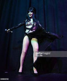 """Cassandra """"Elvira, Mistress of the Dark"""" Peterson performs as she hosts the Viva Las Vegas Rockabilly Weekend's Burlesque Showcase at the Orleans Arena on April 2018 in Las Vegas, Nevada. Get premium, high resolution news photos at Getty Images Dark Pictures, Stock Pictures, Dark Beauty, Gothic Beauty, Divas, Bbc, Cassandra Peterson, Horror Icons, Hollywood"""