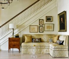 Classic foyer, custom couch, artwork - great use for that awkward part of the house!