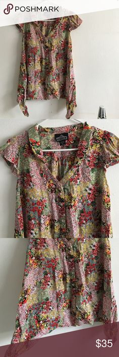 •Gorgeous Floral Button Up V Neck Top• Nwot✨ very lovely top with longer sides than front and back. cute ruffles sleeves with pearly buttons Angie Tops