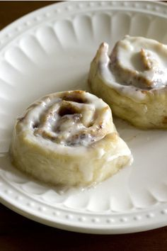 The BEST gluten free cinnamon rolls. Made with simple ingredients and are moist, gooey and soft just like a cinnamon roll should be. No one can ever tell they are gluten free! #glutenfree