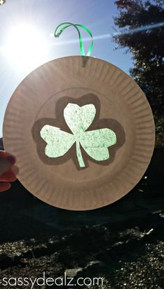 Paper Plate Shamrock Sun Catcher for a St. Patrick's Day Craft #Kids art project | CraftyMorning.com