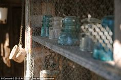 Glass jars kept from being thrown away sit on shelves in Steins, one of the most authentic ghost towns in the United States    Read more: http://www.dailymail.co.uk/news/article-2182753/Stagecoaches-outhouses-general-stores-Inside-preserved-American-ghost-town-left-untouched-70-years.html#ixzz22Ql57Eq0