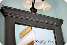 Thrifty Decorating: Frame your bathroom mirror. . .