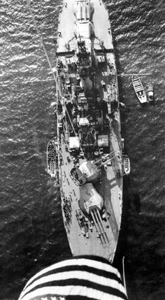 Pre-war picture of 14 in battleship USS Nevada, taken from an observation balloon tethered to her - date unknown. She is best known for being the only battleship to get under way during the Pearl Harbor attack of 7 December 1941, having to be beached to prevent her sinking, but returning to service much modernised to serve with distinction in both Europe and the Pacific.