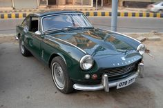 1966 Triumph GT6 in british racing green. Bloody brilliant!