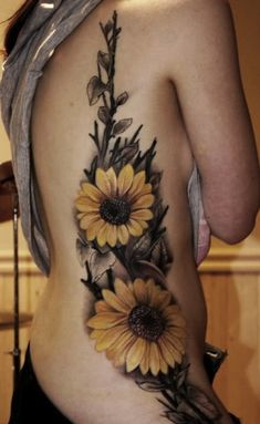 Sunflower Tattoo. I want something like this on my thigh, but all black and gray.