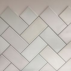 Splashback ideas. Beautiful herringbone tiles, in a beautiful pastel pallet and finished off with grey grout.