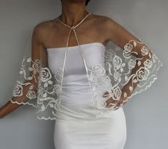 This fairytale bridal cape is made with white tulle with silver gilded rose flower patterns on it., finished at the edges with thin satin ribbon. medium size: Soulder perimeter is cm) and width is cm) Trend alert check out one of the hottest bridal trends Wedding Cape, Bridal Cape, Fairytale Bridal, White Tulle, Cape Dress, Bridal Style, Blouse Designs, African Fashion, Designer Dresses