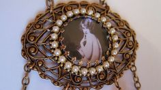 Flapper Pearl Necklace Ziegfeld Girl Brass and Beads 1920s Photo Necklace. $68.00, via Etsy.