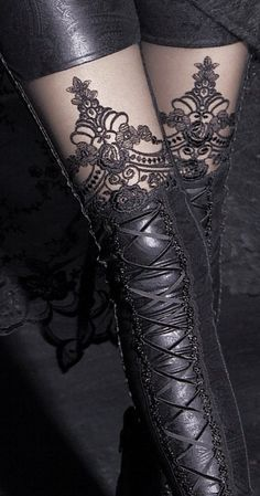 Exquisite Macbeth leggings are made of stretchy black fabric & embroidered black mesh fabric. Shiny material embossed with a swirly design, decorative lacing from the knee down and an embroidered lace