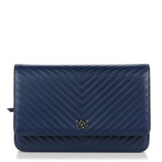 This is an authentic CHANEL Caviar Chevron Wallet On Chain WOC in Navy. This stylish shoulder bag is crafted of luxurious chevron quilted caviar leather in navy blue. The bag features an extra-long silver chain link leather threaded shoulder strap and a frontal faux silver Chanel CC Mademoiselle emblem. This wallet unsnaps to a fabric interior with a panel of card slots and a zippered pocket. This is a marvelous crossbody for day or evening and just the essentials, from Chanel!