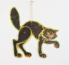 Vintage, jointed, black, Halloween cat from Beistle Co. Cat is printed on one side. Measures approx. 9 x 9, depending on how posed. Has string for hanging. Top right ear and lifted paw have crease lines from being bent. Ear also has a small nick in the colored paper. There is tape in the center back and it has lifted a small area of the colored paper. Back leg has a couple of very light, small white spots. Please see photos for details. Please message us if you have any questions about…