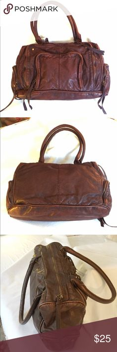 """Converse Vegan Brown Bag In great shape, this multi-pocketed, multi-zippered bag is clean inside and out. Distressed look and feel, this purse will bring out the bohemian in you. Measures 16"""" wide, 10"""" tall, 5"""" deep. Strap drop is 10"""" Converse Bags Totes"""