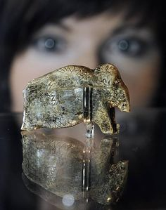 Archaeologists at the University of Tübingen have recovered the first entirely intact woolly mammoth figurine from the Swabian Jura, a plateau in the state of Baden-Württemberg, thought to have been made by the first modern humans some 35,000 years ago. It is believed to be the oldest ivory carving ever found / Aurignacian culture