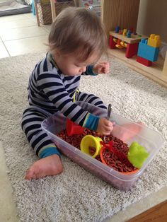 Sensory play. - easy an fun! Beans with objects of different textures. Also good if your child is having trouble with food textures.