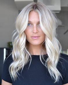 Painted with blonde to perfection! Time to class up your look and opt for these long platinum layers with the middle part style. #middleparthairstyles #layeredhair #platinumblondehair Blonde Layered Hair, Ice Blonde Hair, Platinum Blonde Hair Color, Blonde Hair Shades, Light Blonde Hair, Blonde Hair Looks, Blonde Long Hair Cuts, Bleach Blonde Hair With Roots, Bleached Blonde Hair