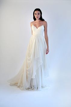 This ethereal and elegantly simple gown combines a luxurious silk bodice with a beautifully draped skirt made of our finest, lighted, most buttery and