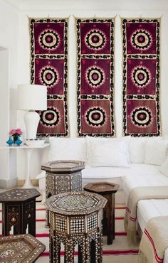 Contemporary interiors with Suzani wall hanging and inlayed tables