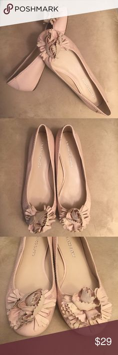 Franco Sarto Astrid Ballet Flats Franco Sarto Astrid Ballet Flats, size 10M, in a pale pink, almost nude color. Faux leather with monotonal stitching and a fun floral embellishment at the toes. Lightly padded, comfortable footbed. These are unworn but show very minimal wear from handling and a mark on the bottom of one shoe, see photos. Sold out style. Franco Sarto Shoes Flats & Loafers