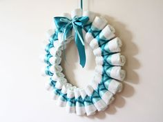 Step by step diaper wreath instructions and pattern for how to make a classy rolled-diaper style of wreath. Create a beautiful and memorable baby shower gift.
