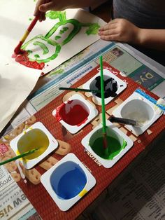 Clever recycled  paint pots from  yoghut containers  and a cereal box