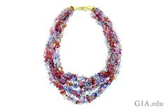 """Some of the many colors of sapphire are on display in """"Dawn"""" – a one-of-a-kind necklace that features 450 carats of sapphire beads."""
