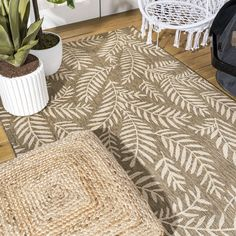 Whether you live in a tropical beach retreat or just love jungalow style, the allover palm frond pattern of this rug brings the jungle home. Scattered palm tree branches create graphic contrast in rich brown and cream tones. The busy pattern is perfect for your tropical patio, entry, kitchen, hallway, living room or bedroom. The pet-friendly and kid-proof flatweave design makes it easy to clean, and perfect for the beach house.