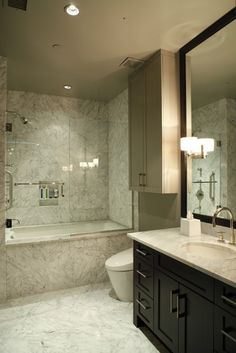 nice slim cabinet, different color than cabinet, darker shade than ceiling - Cravotta Studios -Interior Design