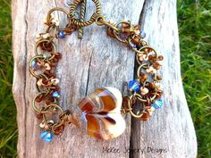 Round Brass large link chain, seed beads, Swarovski crystals with lampwork heart glass bead. Bracelet.