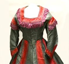 Ca.1865 silk dress with two bodies, two belts, and a sash. Fenimore Art Museum.