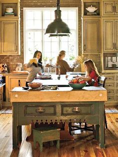 Antique Island Text Size: A A A From Southern Living Get 2 FREE TRIAL ISSUES of Southern Living! A distressed, green, butcher block-topped antique table inspired the entire look for this exuberant kitchen. Green cabinets in a slightly lighter hue and Green Kitchen, Eat In Kitchen, Country Kitchen, Kitchen Colors, Rustic Kitchen, Vintage Kitchen, Kitchen Brick, Kitchen Ideas, Kitchen Size