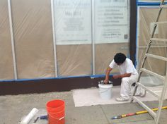 Painting out the front of store.