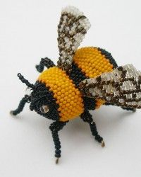 Bumble Bee by Karen Paust, Brooch.  Glass seed beads, wood, wire, nylon thread, sterling silver pin back.