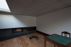 """This lounge room is obviously not designed the same as """"House at Big Hill"""" but its feeling and mood gives the similar vibe of security, simplicity and peace. Through particular use of the timber with black around the fireplace gives an earthy and restful vibe, like """"House at Big Hill""""."""