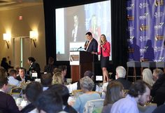 """Emcees David Koehn and Rachel Ryan keep things rolling at """"Jimmy Miller's Bracket Breakfast for Piedmont CASA"""" on March 14, 2016. Image by Jennifer Byrne Photography."""