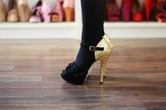 Sparkly heels pop against black tights.